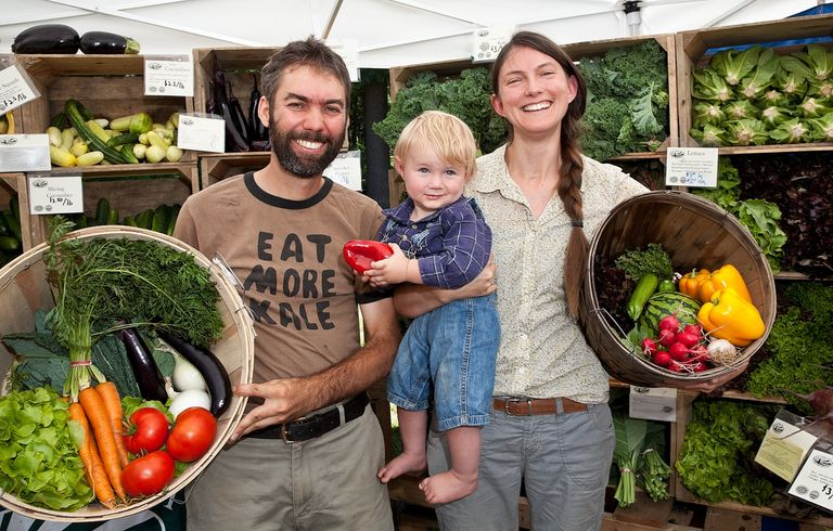 Red Fire Farm owners Ryan and Sarah Voiland with their son at a farmers market