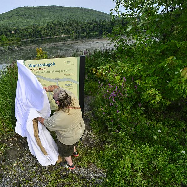 Chief Roger Longtoe Sheehan of the Abenaki unveiling the new sign at Wantastegok. Photo Credit: Kristopher Radder/Brattleboro Reformer