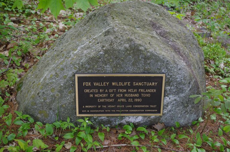 The plaque on a boulder, noting the gift by Helvi Frilander in memory of her husband Toivo